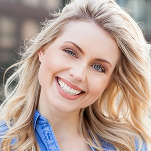 Blonde woman smiling after teeth whitening